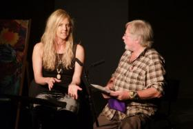 Bill Oddie and Sarah Class on stage.