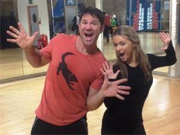 Steve Backshall and Ola Jordan in a dance studio.