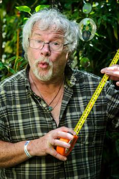 Bill Oddie holds up a tape measure