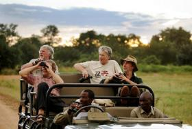 Bill Oddie in a jeep in Zambia