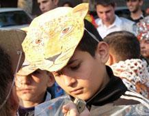Boy in a Caucasian Leopard mask.