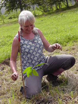 Nicola Davies plants a tree.
