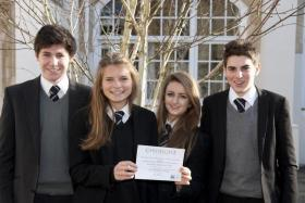 Students from Sevenoaks School hold up their Buy an Acre certificate.