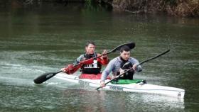 Steve Backshall and George Barnicoat in a kayak.