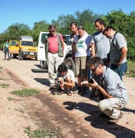 Members of WLT field trip to Paraguay photograph puma tracks.